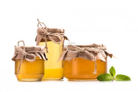 Fresh honey in glass jars