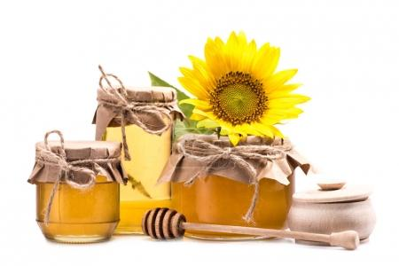 sunflower and honey in glass jars