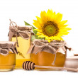 Close-up view of fresh healthy honey in glass jars...