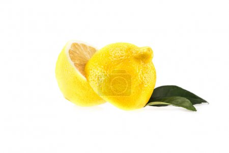 Photo for Yellow halved lemon with leaves, isolated on white - Royalty Free Image