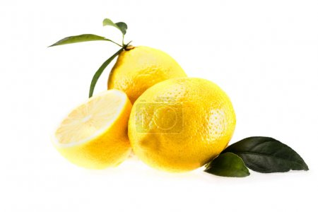 Photo for Yellow juicy lemons with leaves, isolated on white - Royalty Free Image
