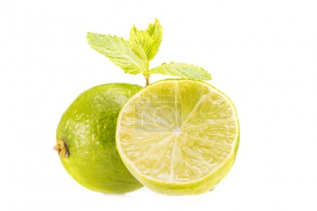 Photo for Fresh sliced limes and mint leaves, isolated on white - Royalty Free Image