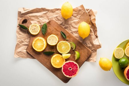 citrus fruits on cutting board