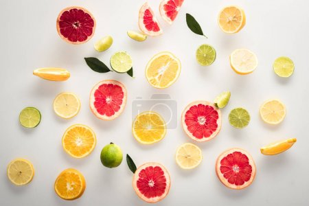 Photo for Sliced citrus fruits background, isolated on white - Royalty Free Image
