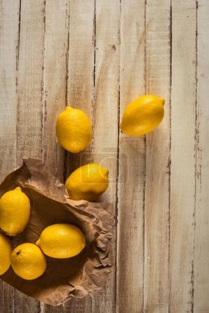 fresh lemons on wooden background