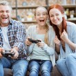 Постер, плакат: Family playing video game