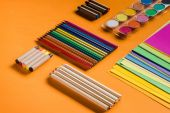 colorful pencils and papers