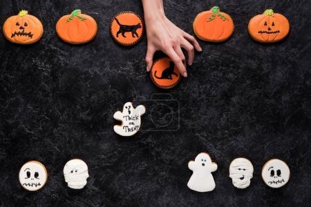 woman holding homemade halloween cookies