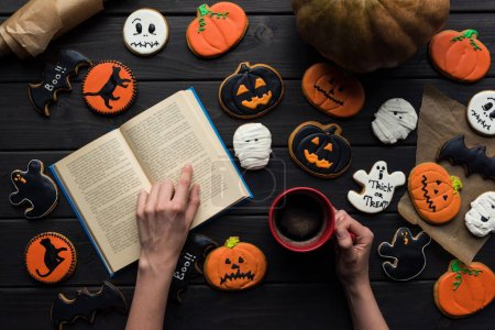 woman reading book on halloween