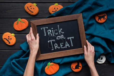 halloween composition with chalboard and cookies