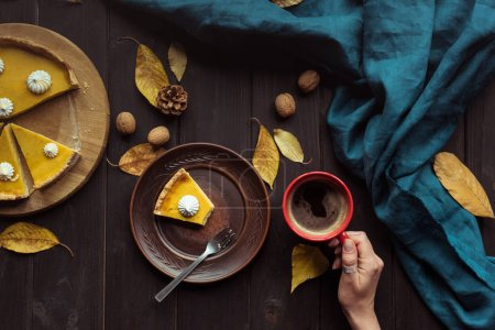 pumpkin pie on wooden table