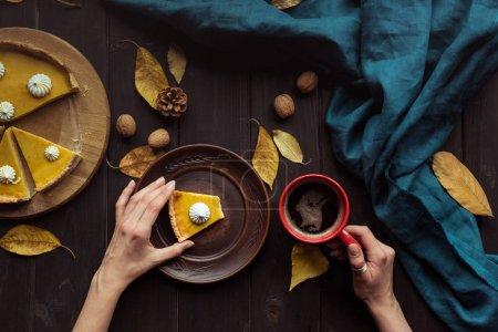 Woman holding pumpkin tart