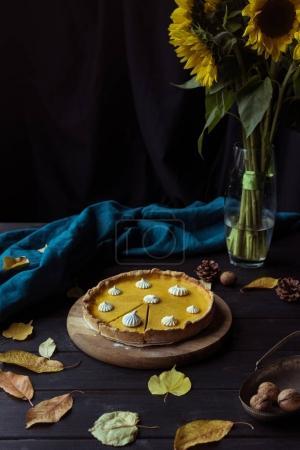 pumpkin pie and decorative sunflowers