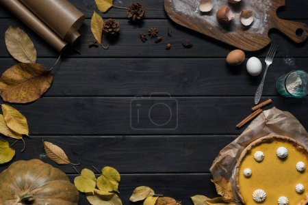 Composition with pumpkin pie and autumn leaves