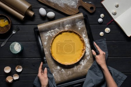 baking tray with pumpkin pie