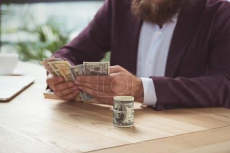 Businessman counting money