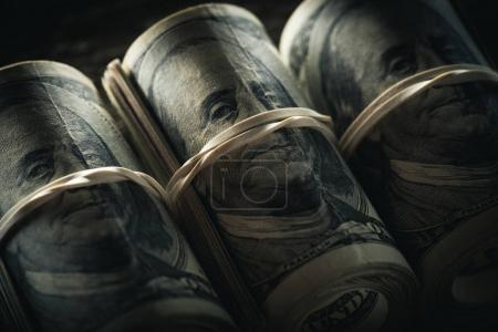 Photo for Close up of dollar banknotes in rolls with rubber bands - Royalty Free Image