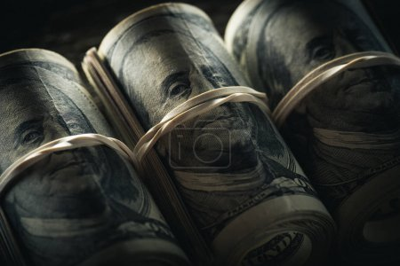 dollar banknotes in rolls