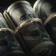 Close up of dollar banknotes in rolls with rubber ...