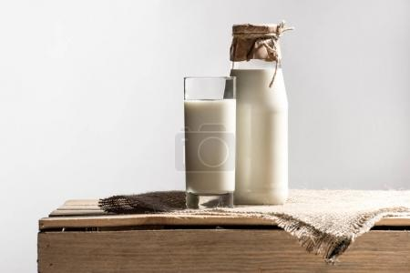 Fresh milk in glass and jar