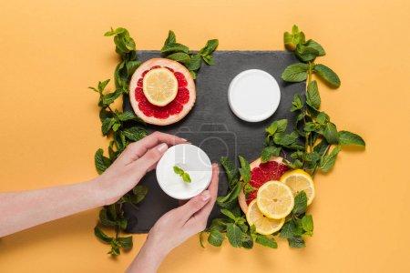 hands with citrus cream