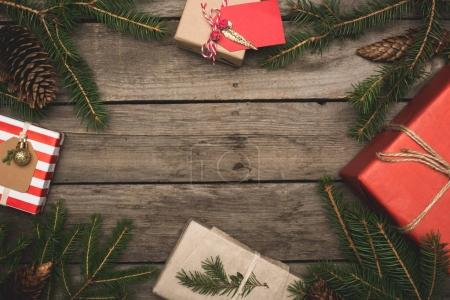 Frame of christmas gifts and branches