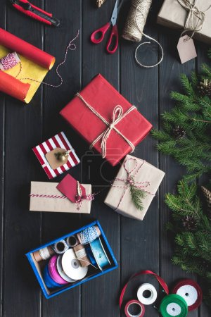 Photo for Top view of christmas gifts composition with wrapping paper and holiday decor - Royalty Free Image