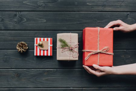 woman placing christmas gift in row