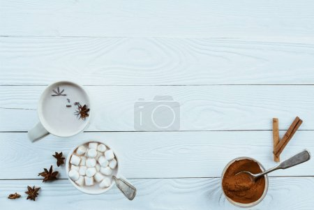 cups of cacao with marshmallow and anise stars