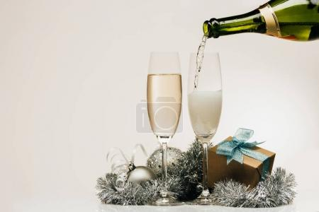 pouring champagne into wineglass