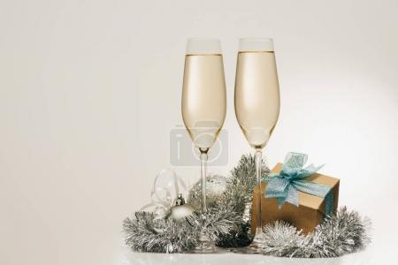 Gift and glasses of champagne