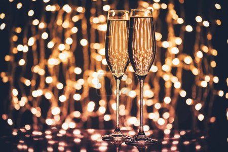 Photo for Selective focus of glasses of champagne against festive lights - Royalty Free Image