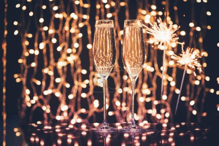 glasses of champagne and sparklers