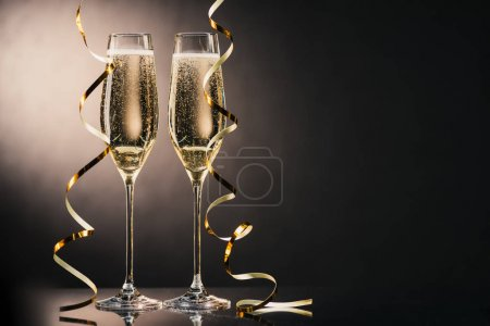 Photo for Close up view of two glasses of champagne with ribbons - Royalty Free Image