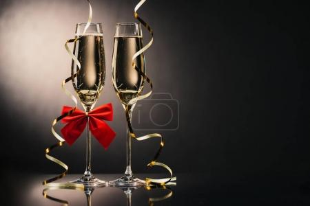 Photo for Two glasses of champagne with ribbons and bow - Royalty Free Image