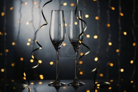 Photo for Selective focus of empty wineglasses and ribbons - Royalty Free Image