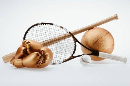 Photo for Closeup shot of various sports equipment - bat, balls, racket and boxing gloves isolated on white - Royalty Free Image