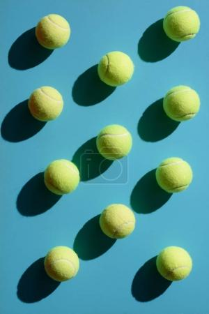 Photo for Top view shot of and tennis balls placed on blue surface - Royalty Free Image