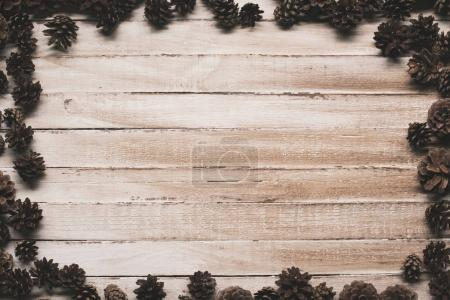 pine cones on wooden surface