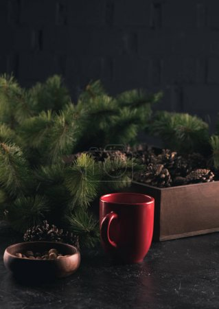 ceramic cup and pine branches