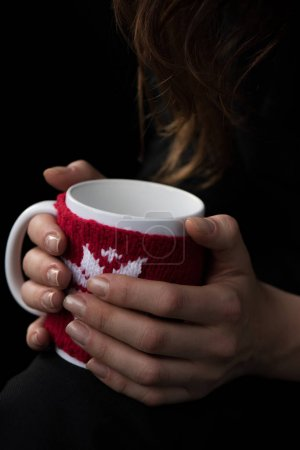 Cup in female hands