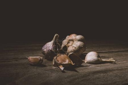 Photo for Close-up view of raw healthy organic  garlic cloves on rustic wooden table - Royalty Free Image