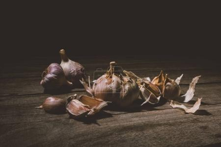 Photo for Close-up view of raw healthy garlic cloves on rustic wooden table - Royalty Free Image
