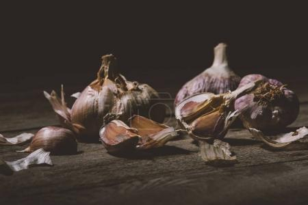Photo for Close-up view of raw healthy garlic cloves on wooden table - Royalty Free Image
