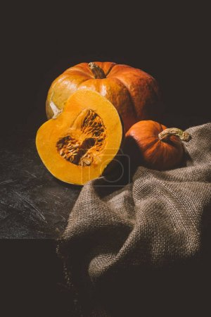 ripe pumpkins on sackcloth