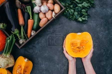 halved pumpkin in hands