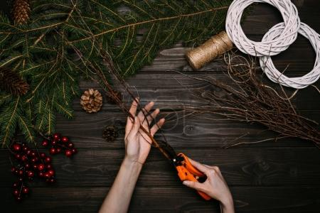 florist cutting branches