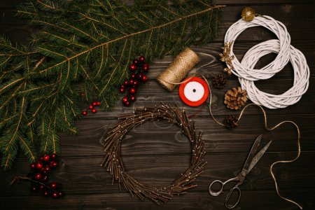 wreath with branches and pine cones