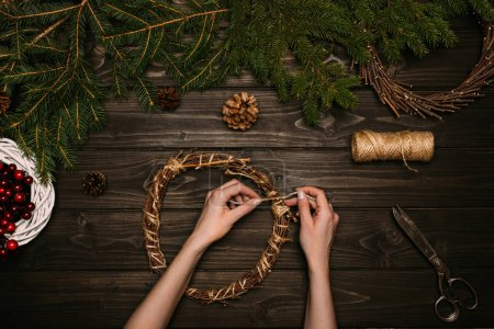 woman making Christmas wreaths
