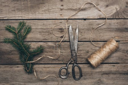 Fir, scissors and twine for Christmas decorations